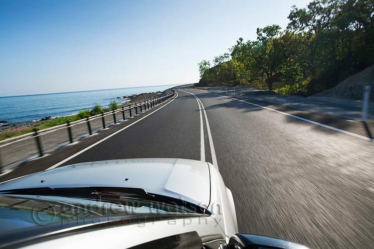 Driving along scenic coastline.  Captain Cook Highway, Cairns, Queensland, Australia