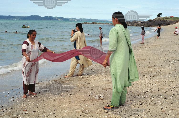 Asian women enjoying a day at the beach.