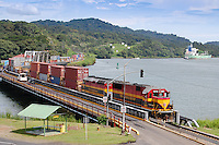 Train crosses bridge between Gatun Lake and Panama Canal, Gamboa Rainforest, Panama.