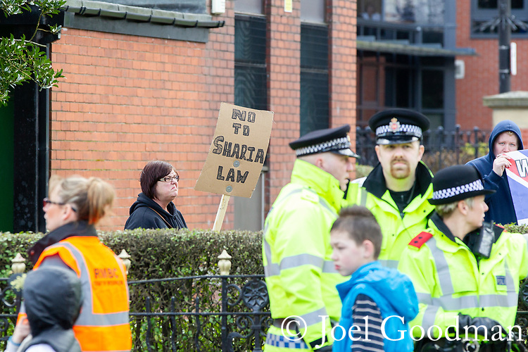"© Joel Goodman - 07973 332324 . 03/03/2012 . Heywood , UK . A woman holds a placard reading "" No to Sharia Law "" . The National Front hold a rally in protest against an alleged paedophile ring that had been operating in the area . There is currently (3rd March 2012) a case being tried at Liverpool Crown Court in relation to the allegations . Last Thursday (23rd February 2012) a protest organised in the town in relation to the same story resulted in Asian business being attacked by an angry mob . Photo credit : Joel Goodman"