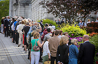 A line forms outside the National Assembly in Quebec City  to see former Quebec premier Jacques Parizeau who lies in state on Sunday June 7, 2015.