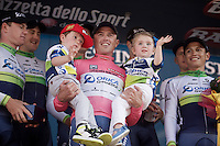 'magnolia rosa' Simon Gerrans (AUS/Orica-GreenEDGE) & kids on the podium after winning the opening TTT of the 2015 Giro d'Italia<br /> <br /> finish zone of stage 1: San Lorenzo Al Mare - San remo (TTT/17.6km)