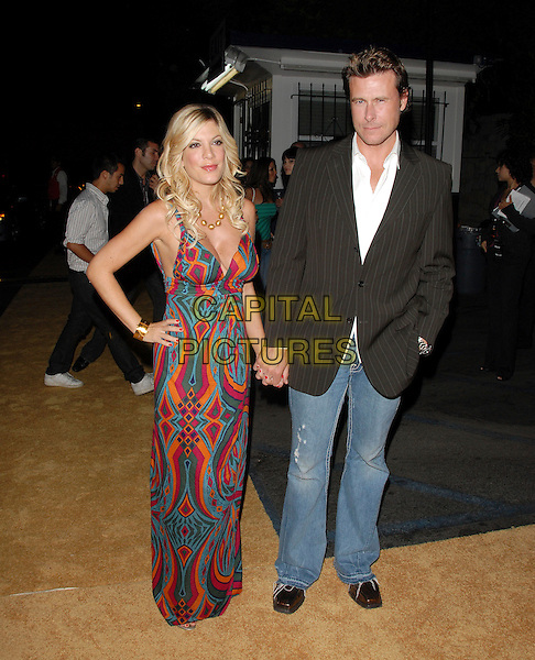 "TORI SPELLING & DEAN McDERMOTT.Mark Burnett & AOL's Launch of ""Gold Rush"" interactive reality competition held at Les Deux in Hollywood, California, USA..September 12th, 2006.Ref: DVS.full length couple married husband wife holding hands jeans denim black pinstripe suit jacket fuschia blue turquoise mulitcoloured pattern dress purple orange blue hand on hip.www.capitalpictures.com.sales@capitalpictures.com.©Debbie VanStory/Capital Pictures"