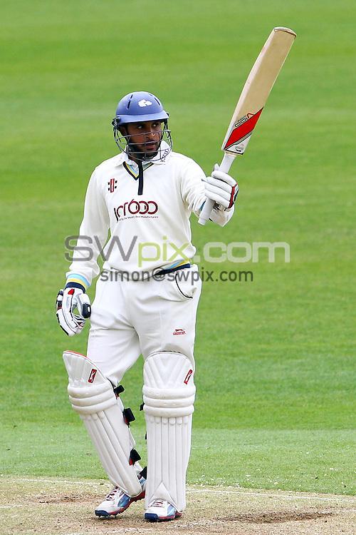 PICTURE BY ALEX WHITEHEAD/SWPIX.COM - Cricket - County Championship - Yorkshire v Somerset, Day 2 - Headingley, Leeds, England - 08/05/13 - Yorkshire's Adil Rashid celebrates 150 runs.