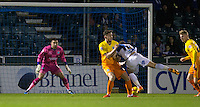 Goalkeeper Matt Ingram of Wycombe Wanderers stands tall against Matty Taylor of Bristol Rovers  during the Sky Bet League 2 rearranged match between Bristol Rovers and Wycombe Wanderers at the Memorial Stadium, Bristol, England on 1 December 2015. Photo by Andy Rowland.