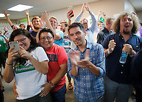 NWA Democrat-Gazette/DAVID GOTTSCHALK  Supporters cheer Tuesday, September 8, 2015 following  the announcement of the passing of the Uniform Civil Rights Administration ordinance at the campaign headquarters for For Fayetteville.