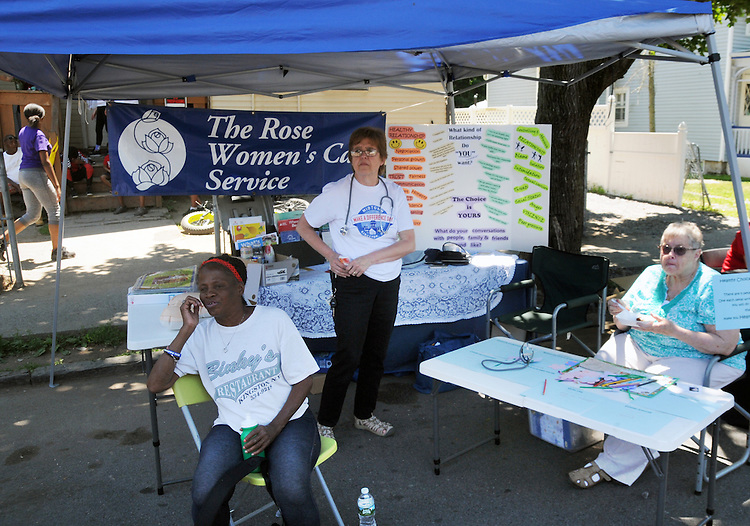 Volunteers at the Rose Women's Care Service Booth one of the many community service groups provided information at various booths at the 11th Annual Mid-town Make a Difference Day Celebration on Franklin Street, in Kingston, NY on Saturday, June  18, 2016. Photo by Jim Peppler. Copyright Jim Peppler 2016.
