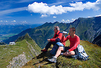 Kaprun, Salzburgerland, Austria, September 2008. Two hikes rest and enjoy the view after climbing Mt Kitzsteinhorn. Mt Kitzsteinhorn is the highest mountain in the region and makes for a really nice scramble to the summit. Photo by Frits Meyst/Adventure4ever.com
