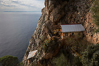 Mount Athos - The Holy Mountain.<br /> Monks look out from a cell which belongs to Father Arsenios, who hasn't left his cell for 64 years. <br /> <br /> Photographer: Rick Findler