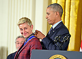 United States President Barack Obama presents the Presidential Medal of Freedom to comedian Ellen DeGeneres during a ceremony in the East Room of the White House in Washington, DC on Tuesday, November 22, 2016.  The Presidential Medal of Freedom is the Nation's highest civilian honor.<br /> Credit: Ron Sachs / CNP