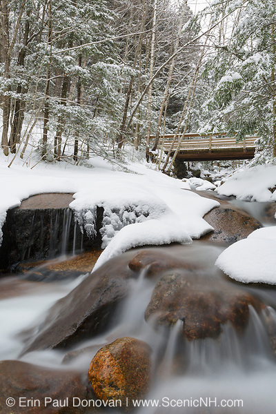 Franconia Notch State Park - Flume Brook in Flume Gorge in Lincoln, New Hampshire covered in snow.