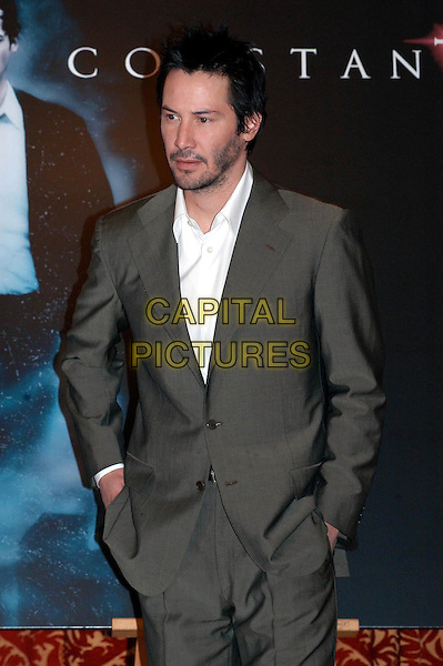 "KEANU REEVES.Photocall for ""Constantine "", Rome, Italy..February 10th, 2005.half length grey gray suit jacket hand in pocket stubble facial hair.www.capitalpictures.com.sales@capitalpictures.com.© Capital Pictures."