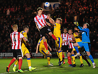 Lincoln City's Sean Raggett vies for possession with Chester's Sam Hughes<br /> <br /> Photographer Chris Vaughan/CameraSport<br /> <br /> Vanarama National League - Lincoln City v Chester - Tuesday 11th April 2017 - Sincil Bank - Lincoln<br /> <br /> World Copyright &copy; 2017 CameraSport. All rights reserved. 43 Linden Ave. Countesthorpe. Leicester. England. LE8 5PG - Tel: +44 (0) 116 277 4147 - admin@camerasport.com - www.camerasport.com