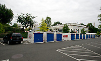 Storage pods on West Executive Avenue outside the White House West Wing in Washington, DC as it is undergoing renovations while United States President Donald J. Trump is vacationing in Bedminster, New Jersey on Friday, August 11, 2017.<br /> Credit: Ron Sachs / CNP /MediaPunch