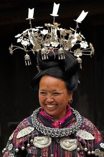 Datang is known as Short-Skirt Miao village. Silver jeweley and headdress show status.  These crowns differ from other Miao minorities.