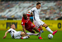 18th July 2020; Liberty Stadium, Swansea, Glamorgan, Wales; English Football League Championship, Swansea City versus Bristol City; Benik Afobe of Bristol City is brought down by Mike van der Hoorn of Swansea City