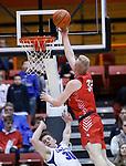 February 28, 2020; Yankton at St. Thomas More High School Basketball -- Matthew Mors #32 of Yankton knocks over Ryan Wojcik #30 of St. Thomas More as he gets a layup during their game Friday evening at Barnett Arena in Rapid City, S.D.(Photo by Richard Carlson/Inertia)