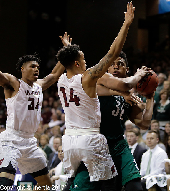 SIOUX FALLS, SD: MARCH 25:  D'Vante Mosby #30 of Northwest Missouri State looks past pressure from Fairmont State defenders Troy Cantrell #34 and D'Ondre Stockman #14 during the Men's Division II Basketball Championship game on March 25, 2017 at the Sanford Pentagon in Sioux Falls, SD. (Photo by Dick Carlson/Inertia)