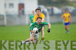 Barry O'Grady of Ballyduff  feels the pressure of Ian O'Mally of Beaufort last Saturday night in Ballyduff.