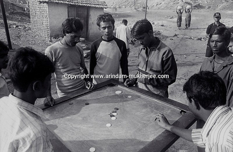 Miners playing carom at a miners' colony in Jharia, Jharkhand, India. Arindam Mukherjee