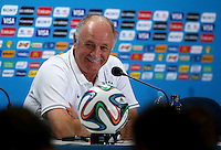 Brazil head coach Luiz Felipe Scolari smiles as he appears relaxed during a press conference ahead of the semi final vs Germany tomorrow