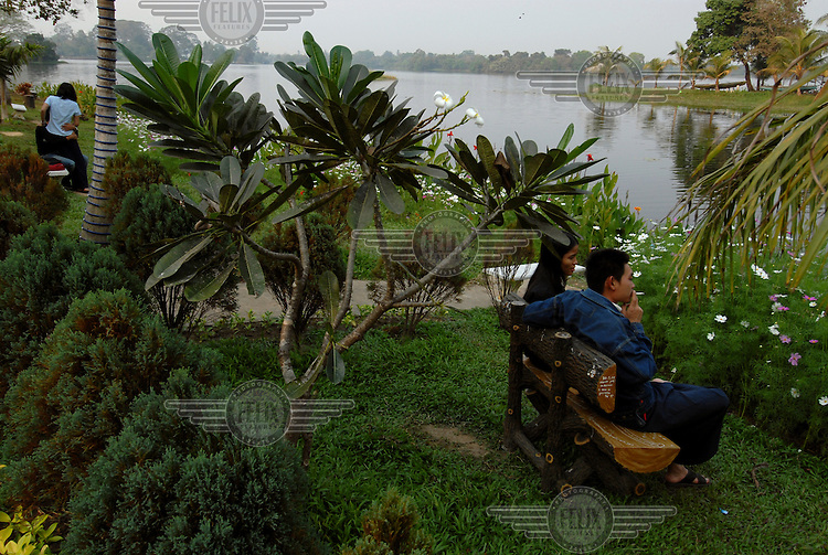 A couple meet in a small park by Inya Lake. Courting couples generally meet in such places. Aung San Suu Kyi's house is also on this lake (where she is under house arrest). Foreigners are not permitted to go on the lake unsupervised.