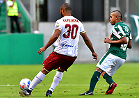 PALMIRA - COLOMBIA, 23-09-2018: Macnelly Torres (Der.) jugador de Deportivo Cali disputa el balón con Luis Payares (Izq.) jugador de Deportes Tolima, durante partido de la fecha 11 entre Deportivo Cali y Deportes Tolima, por la Liga Aguila II 2018, jugado en el estadio Deportivo Cali (Palmaseca) de la ciudad de Cali. / Macnelly Torres (R) player of Deportivo Cali vies for the ball with Luis Payares (L) player of Deportes Tolima, during a match of the date 11th between Deportivo Cali and Deportes Tolima, for the Liga Aguila II 2018 at the Deportivo Cali (Palmaseca) stadium in Cali city. Photo: VizzorImage  / Nelson Rios / Cont.