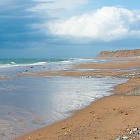 Beach after rain, cloudy sky. Isle of Man.