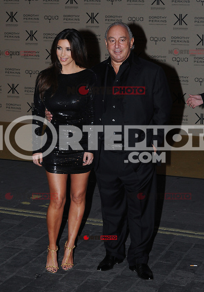 WWW.BLUESTAR-IMAGES.COM.Kim Kardashian and Phillip Green pictured at the Kardashian Kollection launch. The event was to promote their new fashion range for high street chain Dorothy Perkins held at Aqua, London. Uk 08/11/2012.<br /> (Photo:BlueSta/OIC kap1003/NortePhoto