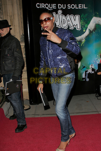 "SONIQUE.VIP Gala Premiere of Cirque de Soleil's ""Quidam"" at the Royal Albert Hall, London, England,  January 6th 2009.Cirque de Soleil shiny puffa jacket v peace sign gesture jeans sunglasses at night pointy shoes .CAP/AH.©Adam Houghton/Capital Pictures"