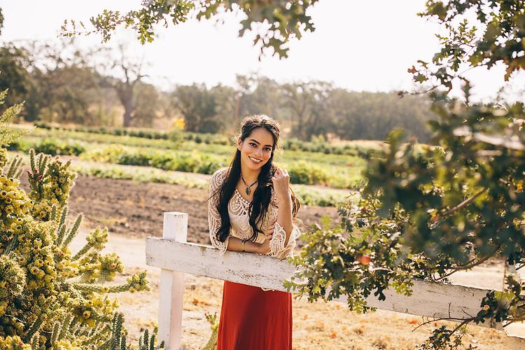 Pretty portrait of a woman at a farm.