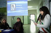 The baby major of Casapesenna takes a speech at the conference for the commemoration of mob's victims. In the slide shown in the background the journalist Giancarlo Siani, killed in Naples by a camorristic commando..In the municipality of Casapesenna teenagers can elect their own delegates, of course with no role other than the one to make teenagers more responsible and closer to institutions and law.