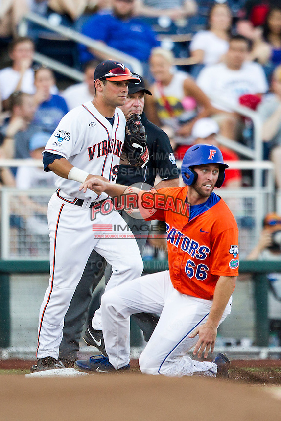 Florida Gators outfielder Ryan Larson (66) slides into third base against the Virginia Cavaliers in Game 13 of the NCAA College World Series on June 20, 2015 at TD Ameritrade Park in Omaha, Nebraska. The Cavaliers beat the Gators 5-4. (Andrew Woolley/Four Seam Images)