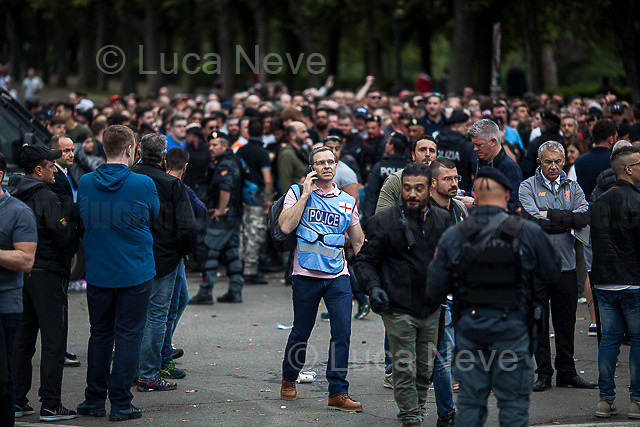 Merseyside Police's officers (British Police).<br /> <br /> Villa Borghese.<br /> <br /> Rome, 02/05/2018. Following and documenting a group of Liverpool F.C. supporters chanting and cheering on throughout the streets of central Rome while waiting for the Champions League Semi-final (second leg) at the Stadio Olimpico versus A.S. Roma. The supporters were escorted by heavy presence of the Italian Police and Carabinieri, assisted by Merseyside Police's officers (British Police) and by the stewards and staff from Liverpool Football Club. Last week, during the first leg of the semi-final in Liverpool, an English fan was attacked by Italian supporters outside Anfield stadium. However, the day of the match in Rome passed without any serious incidents involving supporters and just one arrest - a Liverpool supporter - was made (on suspicion of common assault and a public order offence). The actual match was played in the evening and saw Liverpool losing 4-2 but due to the aggregate with the first match, 7-6, the &quot;Reds&quot; conquered the access to the Champions League final in Kiev against Real Madrid. A statement from the English club read: &quot;Liverpool would like to thank all supporters who travelled to Rome for Wednesday evening's Champions League meeting with Roma at Stadio Olimpico for their exemplary conduct. Over 5,000 fans made the journey to the Italian capital for yesterday's semi-final second leg, behaving impeccably throughout, with no major incidents reported. LFC also acknowledges the significant resources deployed by Roma, UEFA, Merseyside police, Italian police and security services in Rome to ensure all fans enjoyed a safe visit.&quot;<br /> <br /> For more info about the football teams please click here: http://www.asroma.com/en &amp; http://www.liverpoolfc.com/