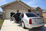 Jean and her daughter Paris with the family's Cadillac, in the front drive of their home. English Romanichels whose family came to the USA at the beginning of the twentieth century. Texas, USA 2006