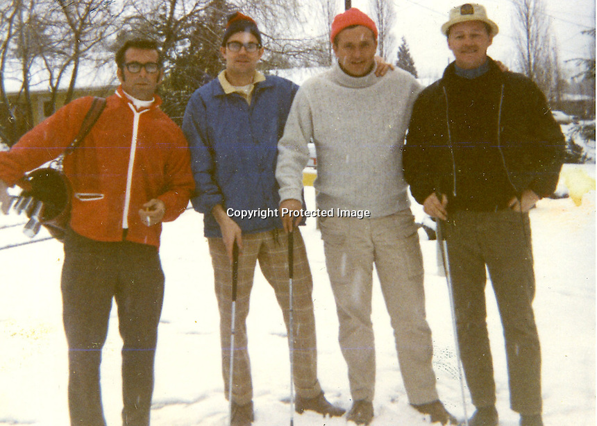 (Four fool playing golf in snow)<br />