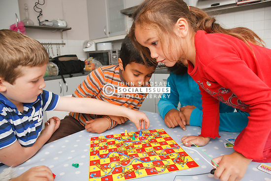 Children playing snakes and ladders game