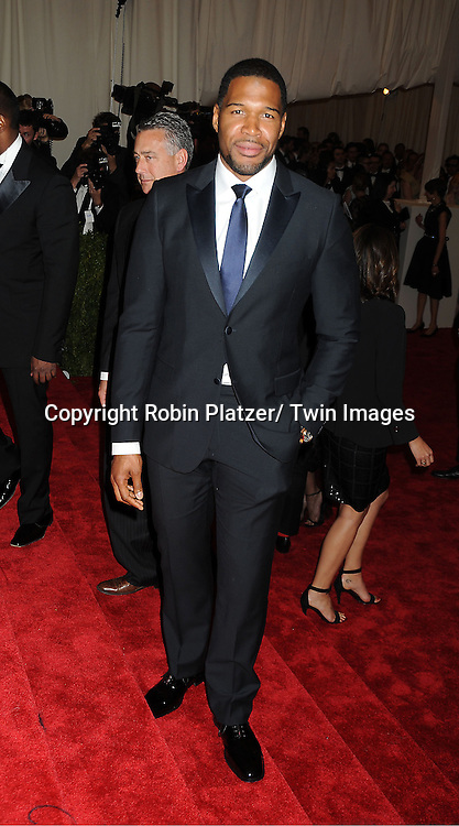 Michael Strahan attends  the Metropolitan Museum of Art Costume Institute Beneift celebrating the opening of  PUNK: Chaos ..to Couture on May 6, 2013 in New York City.
