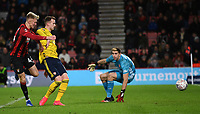27th January 2020; Vitality Stadium, Bournemouth, Dorset, England; English FA Cup Football, Bournemouth Athletic versus Arsenal; Sam Surridge of Bournemouth shoots and scores past keeper Martínez in extra time for 1-2