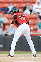 Hickory Crawdads Jurickson Profar #10 squares to bunt during a game vs. the Hickory Crawdads at L.P. Franz Stadium in Hickory,  North Carolina;  April 7, 2011.  Hickory defeated Asheville 4-2.  Photo By Tony Farlow/Four Seam Images