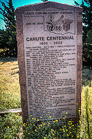 Canute Centenial Marker on Route 66 on Canute Okalhoma.<br /> <br /> Canute Centennial<br /> 1902-2002<br /> Town Chartered July 2, 1902 - Canute established Oklahoma Territory<br /> Canute City lots sold by lottery for $10.00 per lot<br /> 1902 - 1st State Bank receives charter<br /> 1904 - Water well dug in middle of Main street with windmill for horses rode to town<br /> 1904 - Rural mail delivery started<br /> 1905 - Big wolf hunt south of Canute, Oklahoma Territory<br /> 1907 - Railroad and Depot comes to Town<br /> 1907 - November 16, Oklahoma becomes a state<br /> 1908 - Canute Consolidated School District #1 started<br /> 1917 - First Oil and Gas well drilled in area<br /> 1924 - Electrification comes to Town<br /> 1925 - First Phone lines in Town<br /> 1925-28 - Holy Family Catholic Church, School , rectory and convent Built<br /> 1928 - Grotto/Crucifiction Built<br /> 1929 - Great Depression starts<br /> 1931 - US 66 opened through Canute to Texas line<br /> 1936 - City Park 1st Okla State Park built on Route 66<br /> Apr. 7, 1938 - Snowstorm of the century filled in Old 66 RR underpass west of Town stopped Rt 66 traffic for 10 days<br /> Aug. 14, 1945 - Bells rang when Japan Surrendered<br /> 1955-58 - Serious dry spell and drought for farmers<br /> 1962 - Canute public water and sewer system installed<br /> 1964 - Volunteer Fire Department officially started<br /> 1967 - I-40 bypasses Town<br /> 1979 - Farm land prices hit record highs<br /> 1970's - 80's - Oil Boom - 1980's Oil Bust<br /> 1984 - New modern school gymnasium built in Canute<br /> 1990-94 - Native of Canute David Walters elected Governor of Oklahoma<br /> 1994 - Heritage Center purchase/renovation (Old Holy Family Church)<br /> 1992-2000 - Randy Beutler State Representative<br /> 1992 - to present - Jack Bonny State Representative<br /> 1997 - Girls Basketball State Champs<br /> 1997 - Internet acess first available<br /> 2001 - Space Port Authority formed for the area<br /> 2002 - Major Ice Storm shuts down electricity for 5 days<br /> Manufactured by Willis Granite Products Granite, Oklahoma