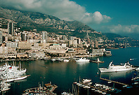 Port of Monaco with luxury yachts, buildings on hillside. Monte Carlo, Monaco