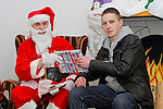 Lee Maguire visits Santa in his grotto at the Youthreach Party..Picture: Shane Maguire / www.newsfile.ie.