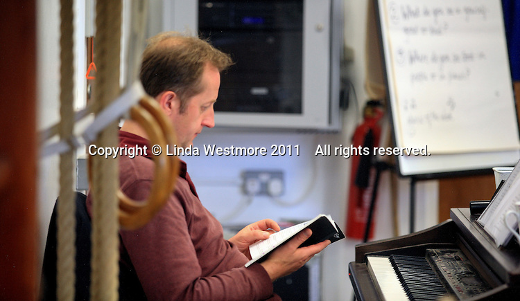 """Musical Director, David Perkins.  The Yvonne Arnaud Youth Theatre rehearsing """"The Lion, the Witch and the Wardrobe"""", Guildford, Surrey."""
