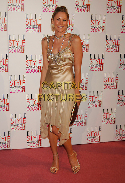 JENNI FALCONER.Elle Style Awards 2006.The Old Truman Brewery, Brick Lane.London, England.20th February 20th, 2006..full length jenny gold dress satin silk beads necklace pearls.Ref:PL.www.capitalpictures.com.sales@capitalpictures.com.©Phil Loftus/Capital Pictures.