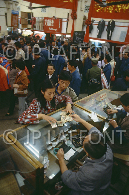 October 1984. In Shanghai, a large department store on Nanking Road, the Chinesse on the weekend are shopping for everything they can afford.