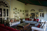 Rohet Garh fortress palace hotel salon drawing room with photographs of aristocratic ancestors Rohet, Rajasthan, India