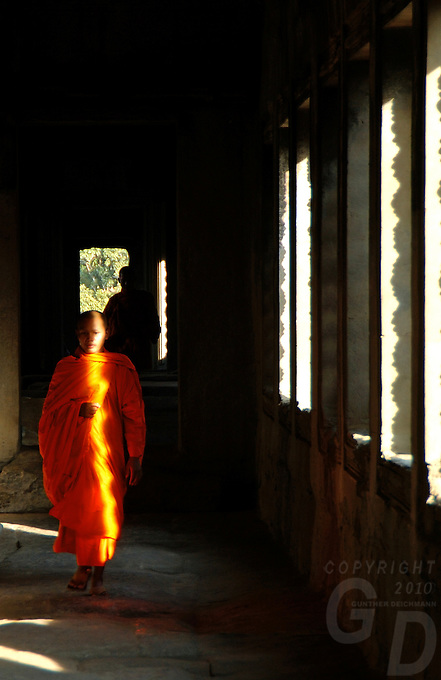 Images from the Book Journey Through Colour and Time<br /> Monk walking in the corridors Inside Ankor Wat,Cambodia, Siam Reap