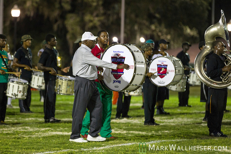 TALLAHASSEE, FL - SEPTEMBER 5, 2013:   Dr. Sylvester Young, director of marching and pep bands, positions members of the band during the FAMU Marching 100 band practice on the Florida A&M University campus.