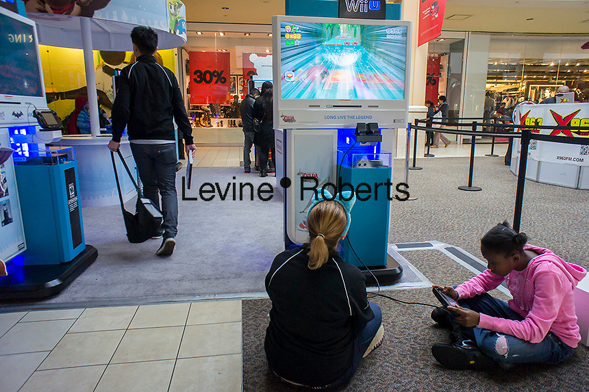 The Nintendo Wii kiosk in the Queens Center Mall in the borough of Queens in New York on Sunday, December 15, 2013 looking for bargains. A study by the National Retail Federation says that $600 billion in hoilday purchases will be made by Americans, accounting for 19.3% of all retail sales. (© Richard B. Levine)